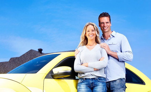 Couple with new car that has automobile insurance in Brooklyn